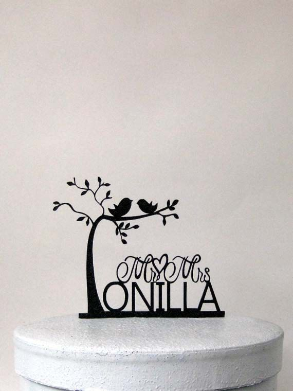 This Personalized two birds on tree Wedding Cake topper comes with  Mr & Mrs last name  Size; 5.85W x4.75H  Topper is lightweight so it will not