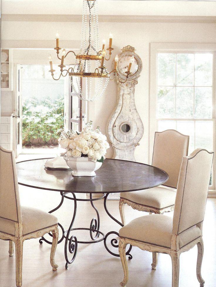 iron table + swedish clock + empire chandelier