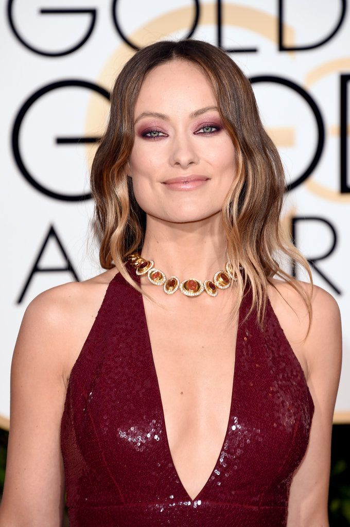 It's Almost Unreal How Flawless Olivia Wilde Looks in This Low-Cut Red Gown: Sure, there were a ton of great looks on the Golden Globes red carpet, but perhaps none as stunning as Olivia Wilde's sparkly red number.
