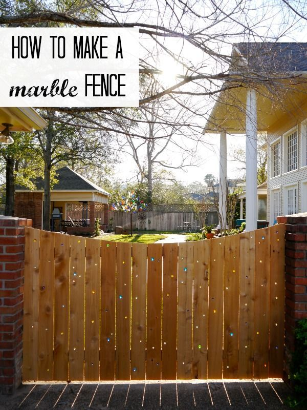 Make your fence sparkle with marbles- beautiful!