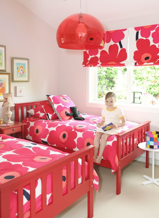 The Marimekko Unikko print in red is bright and bold. It is perfect for decorating a little girl's room. Bedding and fabric available at http://kiitosmarimekko.com/products/unikko-pieni-unikko-us-sized-bedding-red