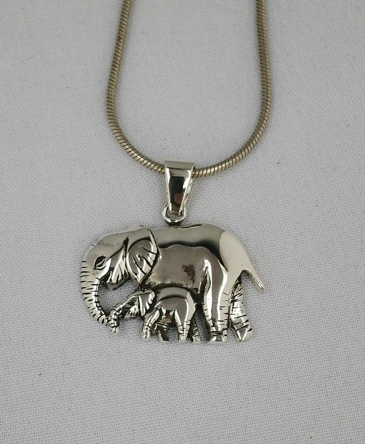 Sterling silver pendant of an elephant with its baby.