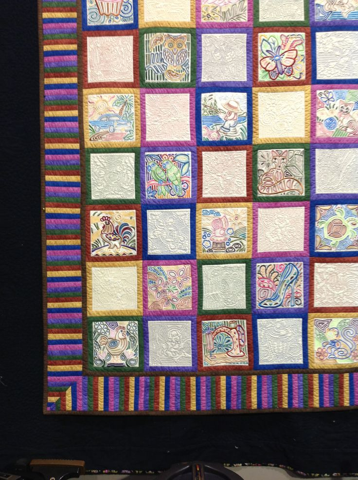 My 'I Spy' quilt with Mola embroidery designs from Embroidery Library.