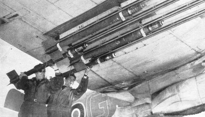 A view of rockets being loaded onto the guide rails under the wings of a Bristol Beaufighter. This aircraft was probably part of No.404 (RCAF) Squadron.