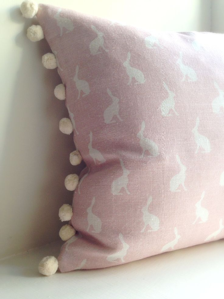 Hop Hop little bunny! These adorable oblong cushions are lovingly handmade in Peony & Sage Mini Hops Pink Icing linen with the softest ivory pom pom trimming along two side edges. Our cushion features this gorgeous mini hops design on both sides to offer a fully reversible option with a discreet zip closure to the bottom. Designed to co-ordinate with many of our accessories & bespoke children's room packages including lampshades, bunting & memo boards. Each cushion includes a ...