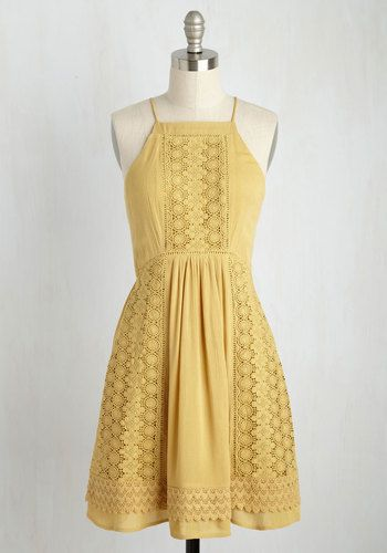 Before tossing a colorful salad to enjoy with your bestie, slip into this muted yellow sundress for a visit to the garden where the veggies were grown! Bursting with lush life, the rows of organic edibles make a marvelous backdrop for the tapered neckline, crocheted lace panels, and tiered hem of this boho-inspired frock. Brilliant!