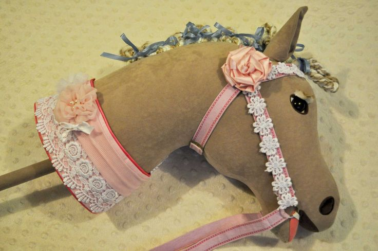 Flower trim for the Bridle plus Border lace and a Child's Headband on the Neckband.