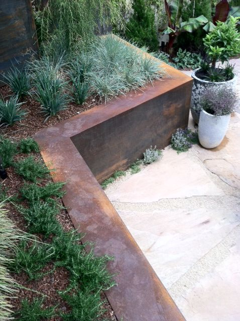 CORTEN STEEL retaining walls terrace a back garden. RS McDANNELL