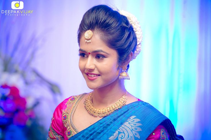 South Indian bride. Temple jewelry. Jhumkis. Blue silk kanchipuram sari.Bun with fresh jasmine flowers. Tamil bride. Telugu bride. Kannada bride. Hindu bride. Malayalee bride.Kerala bride.South Indian wedding