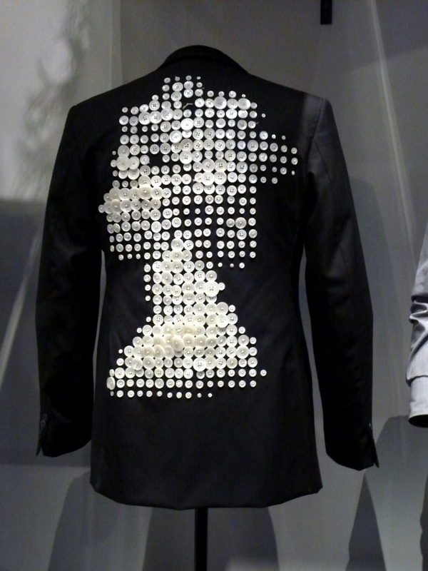 Pearly Queen' suit made by tailors of Nutter of Savile Row which reinterprets 'pearly' outfits of Victorian market traders which were completely covered with buttons.