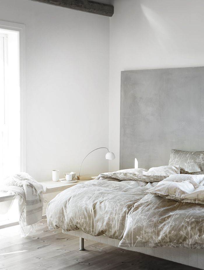 Extra large canvas in soothing gray tones as headboard. Perfect.