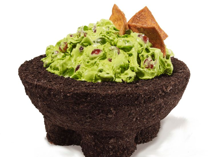 Guacamole Cake : This cake looks like a traditional Mexican mortar (called a molcajete) filled with chunky guacamole. To make it, we baked a chocolate cake in a bowl and attached three cupcakes for the legs. We covered the whole thing with frosting and ground cookies to look like stone, then we filled it with green-tinted, cherry-studded ice cream.
