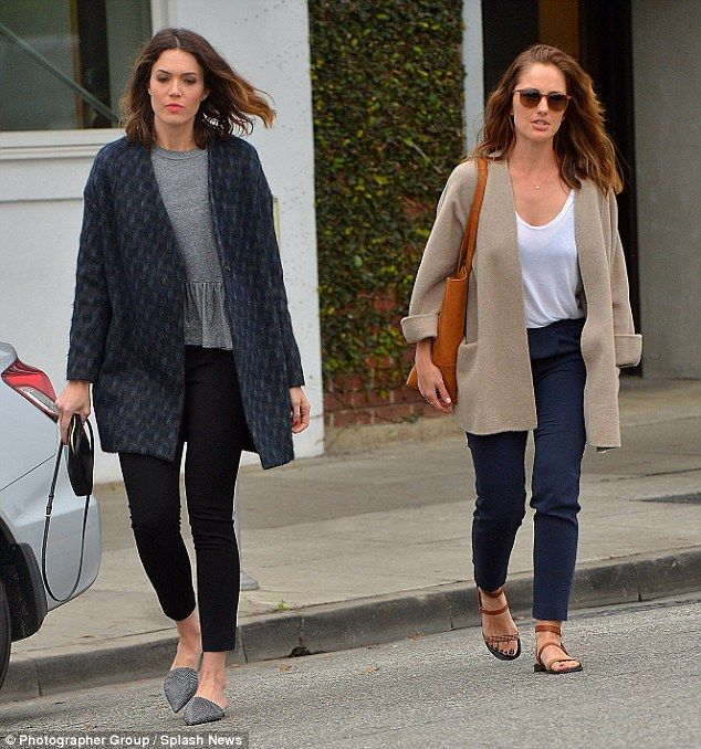 Someone to lean on: Newly single Mandy Moore stepped out with BFF Minka Kelly in LA on Wednesday less than two months after filing for divorce from rocker Ryan Adams