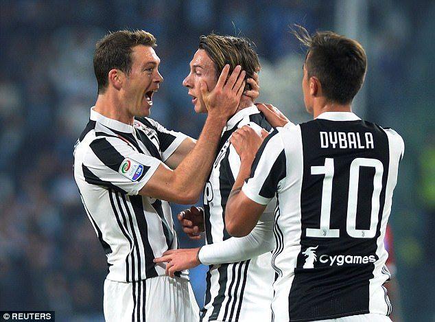 Bernardeschi (centre) is congratulated on his fine strike by his Juventus team-mates