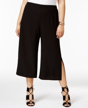 Boldly breezy, these plus size culottes from Ny Collection step up the style with chic side slits.   Polyester/spandex   Machine washable   Imported   Mid rise; relaxed fit through hips and thighs; wi