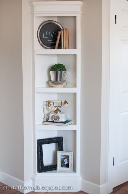 "Built In Shelf {the easy way} & tutorial - How to take a shelf and make it ""built in"". Would be pretty easy to make the corner shelf itself"