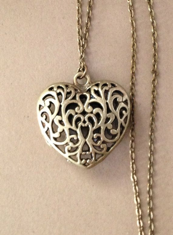 Long Bronze Filigree Heart Necklace by sarahrodger on easy.com