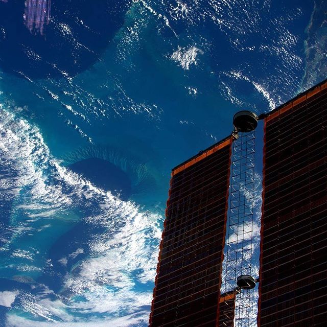 The Caribbean's blue hues contrast with the International Space Station's orange solar arrays in this photo taken by Thomas Pesquet.  Credits: ESA, NASA  #ShadesofBlue #Blue #hues #contrast #colours #orange #sea #caribbean#internationalspacestation #astronaut #space #earth