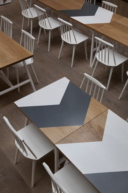 chevron pattern tabletops of the cornerstone cafe by paul crofts studio - Painted Wood Cafe Decoration