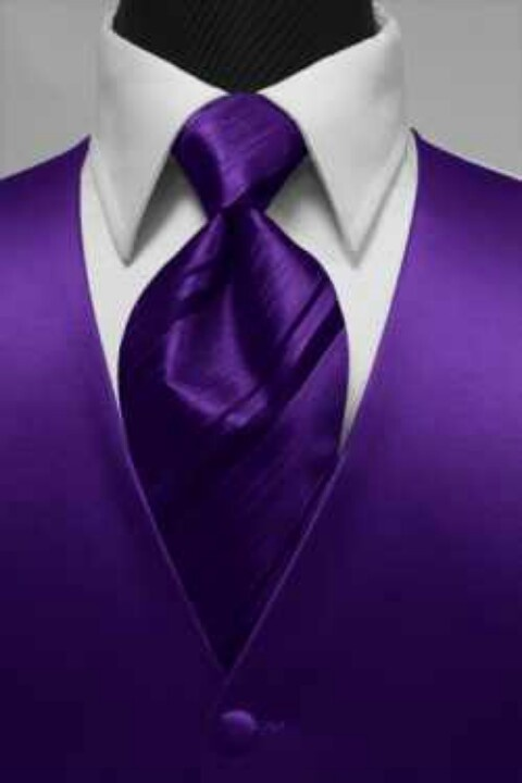 Groom in white tux with purple vest but a white tie