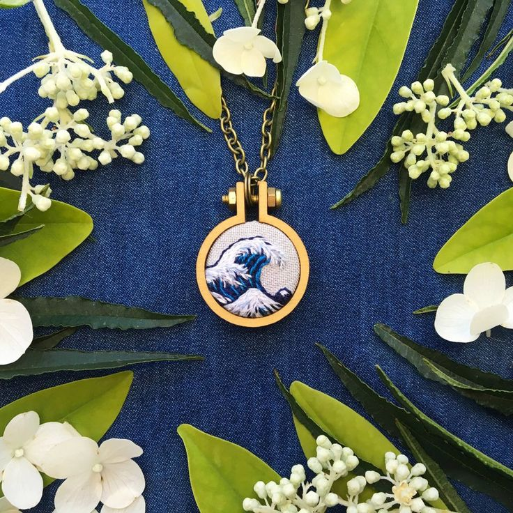 This miniature Hokusai recreation of The Wave is hand embroidered one stitch at a time. This piece is inspired from my love of art history. The pie...