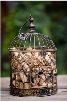 Love this wine cork decor - I'm going to do this with the birdcage from our wedding!