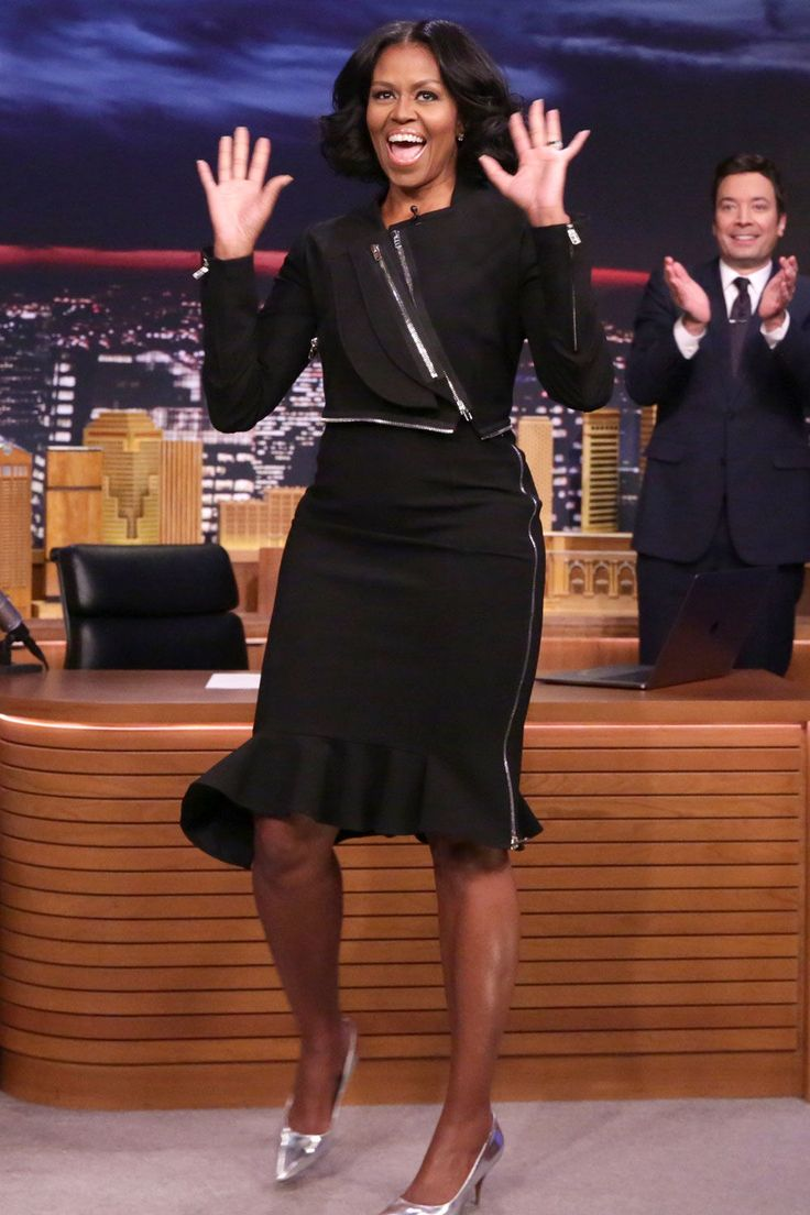 The First Lady wearsa black zippered knee-length dress by Givenchywith silver pumps on The Tonight Show.