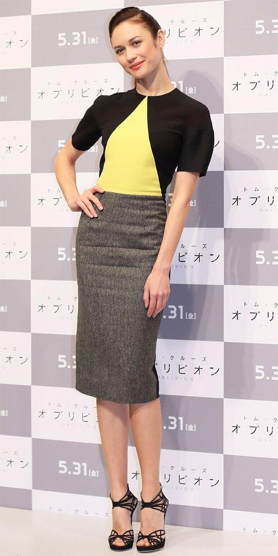 Olga Kurylenko hit an Oblivion press event in Tokyo wearing a colorblock sheath and webbed sandals.