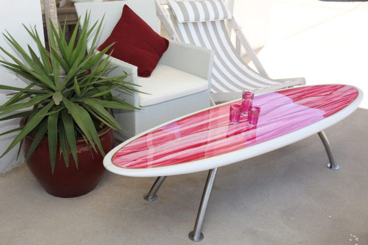 Surfboard table. More here: http://www.completely-coastal.com/2009/10/designers-who-take-surfboard-inside.html