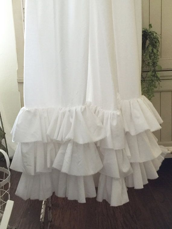 Farmhouse, Shabby and Beach decor all rolled in to one shower curtain.  Pure white accented with three rows of tattered ruffles.  8 ruffle  72 x 72 Standard Shower Curtain Size  Choose you length during checkout. PLEASE SPECIFY EXACT LENGTH WANTED DURING CHECKOUT  Plastic Liner not included, but recommended  Wash and dry