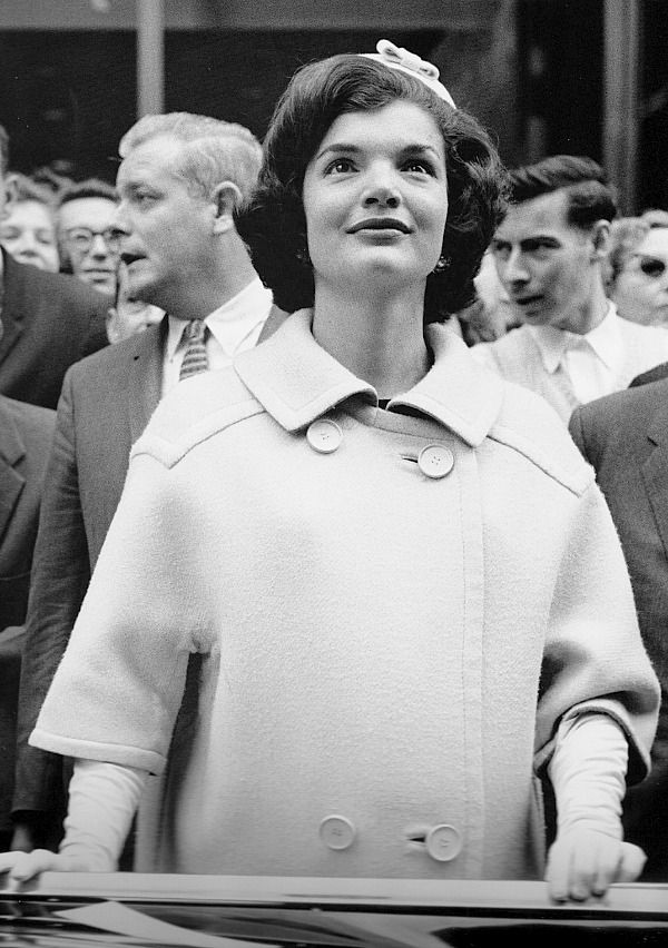 """October 19, 1960.  Thirty-one-year-old Jackie Kennedy was magnetic on the campaign trail.  While her travel had been limited due to pregnancy, she reemerged on an important swing through New York City in October.  Kenny O'Donnell would later write: """"She was always cheerful and obliging, never complaining, and…did not bother to put on a phony show about everything that she saw and every local politician whom she met.  The crowds sensed that and it impressed them.""""  Photographed by Henri…"""