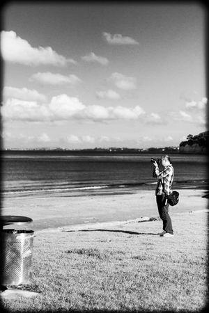 Fellow photographer at the beach #beach #nz #new #zealand #photographer #bw