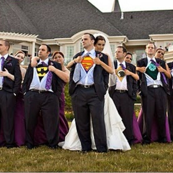 Amazing and adorable idea. Have all the men wear superhero symbols under their shirts and have the girl pull their shirt back!