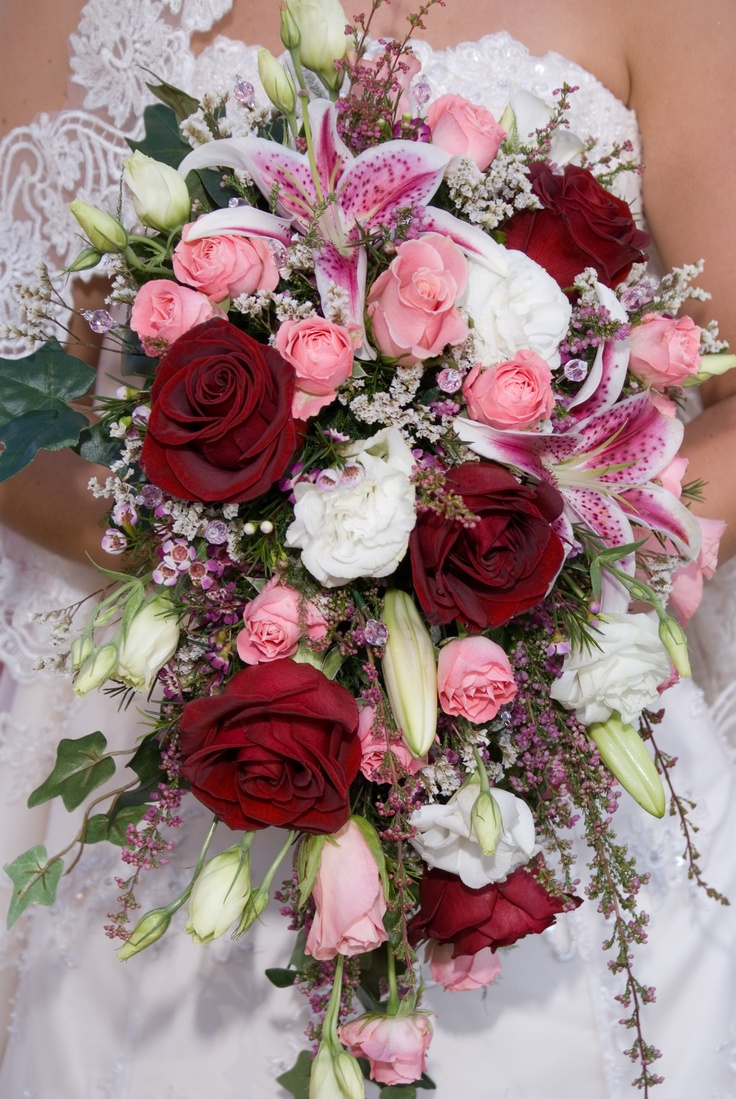 Wedding Bouquets With Rainbow Roses : Traditional cascade bridal bouquet of pink roses