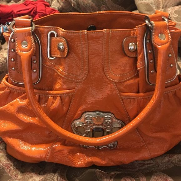 Kathy Van Zeeland Purse Beautiful Orange purse. Perfect for Spring. 3 pockets on the outside. Divider on inside.  Used a few times. Kathy Van Zeeland Bags Satchels