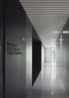 Show room Roca by Francesc Rife /// The use of louvers creates an elegant pattern of light and shadows.