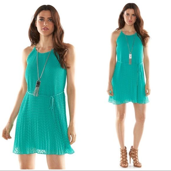 "ELLE Green Pleated Trapeze Dress ELLE green pleated trapeze dress will make you feel fabulous!  FEATURES: Textured mushroom-pleat design, Crewneck with button-back closure, Spaghetti straps, Lined Coordinating sash.  *M (8-10), L (12-14), XXL (20-22) *32 1/2"" approx length  *Dress & Lining 100% polyester *Machine Wash *Also available in coral and navy blue in separate listings to purchase & bundle   BUNDLE DISCOUNTS, NO TRADES, SMOKE FREE Elle Dresses"