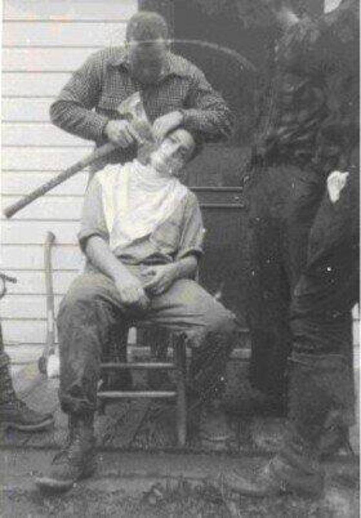 Lumberjacks shaving with an axe, 1930s