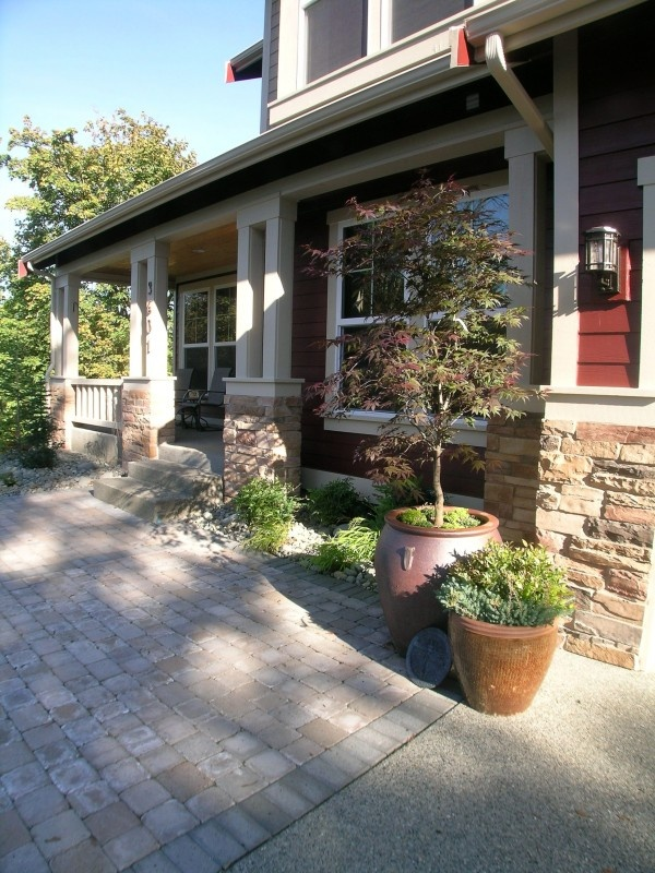 Using Rocks Instead Of Mulch In Flower Beds Reduces The