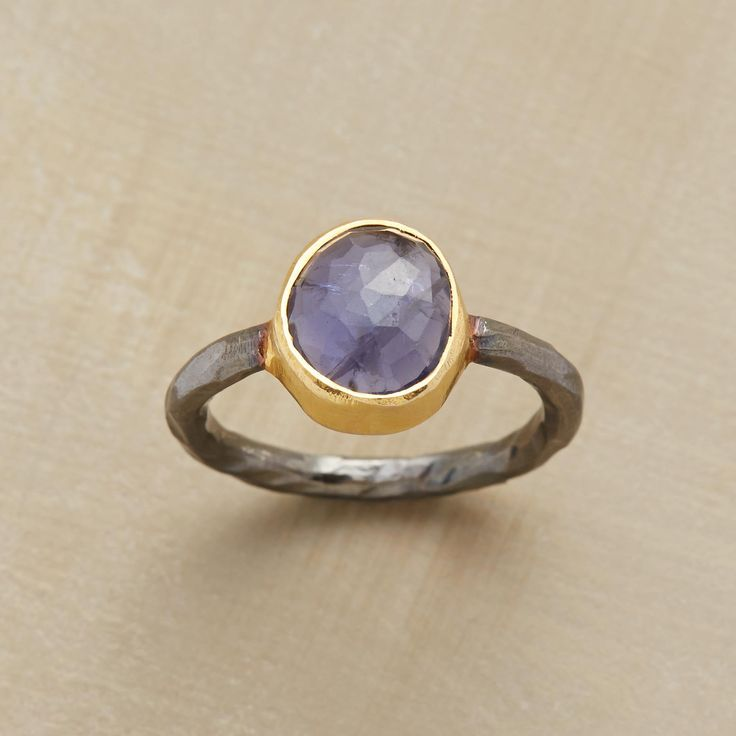 CONVERGENCE POINT RING.A deep bezel of 22kt gold vermeil and an oxidized sterling silver band come together in a ring bearing a single, shimmering dome of iolite.