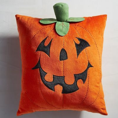 Our jack-o'-lantern pillow doesn't light up, but it is ready for Halloween. With…