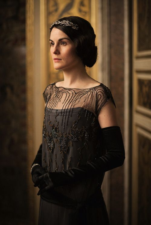 Michelle Dockery as Lady Mary Crawley wearing a black beaded evening gown with sheer bodice,  Downton Abbey