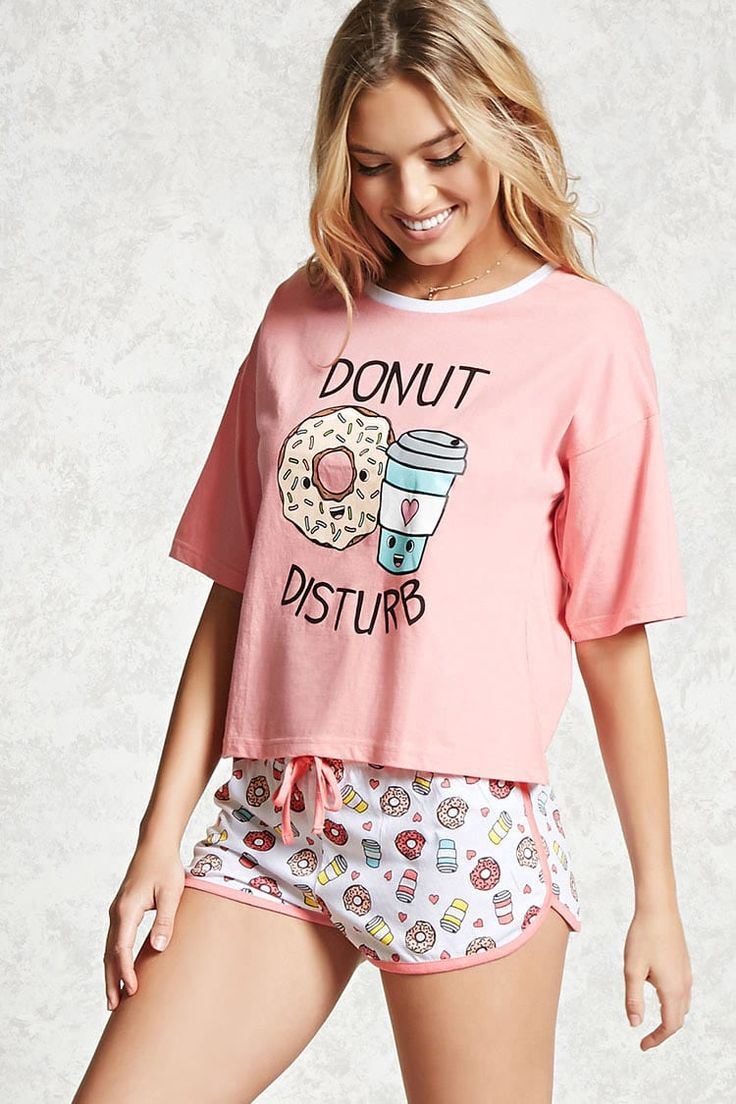 """A PJ set featuring a knit tee with """"Donut Disturb"""", a donut, and coffee graphics, short sleeves, a contrast round neck, complete with a pair of knit shorts with a donut and coffee cup print, contrast piping, and an elasticized drawstring waist."""