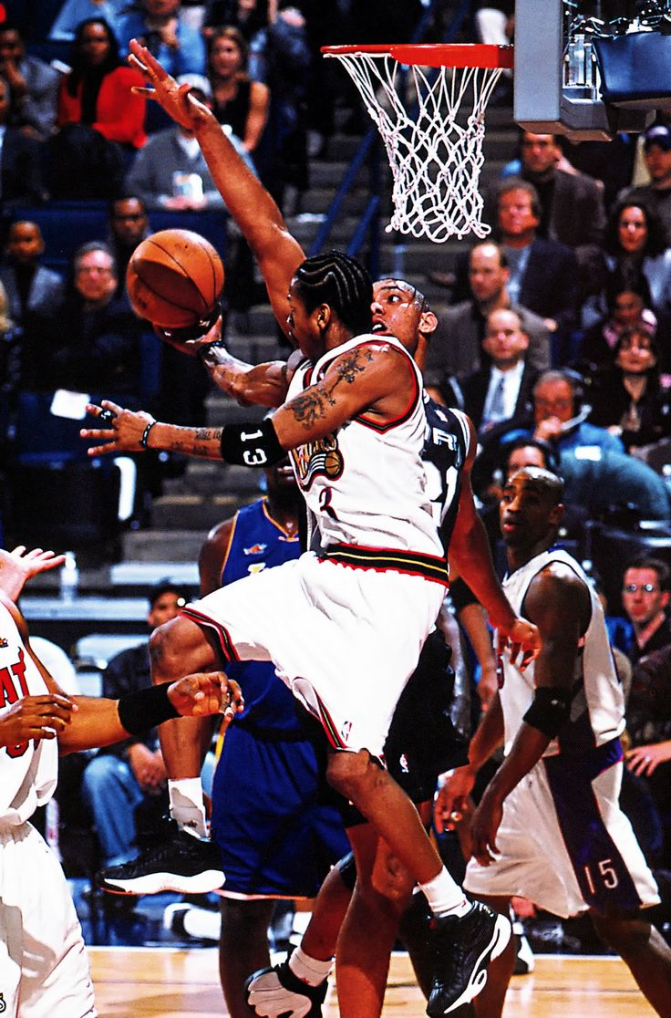 Allen Iverson shoots over Tim Duncan