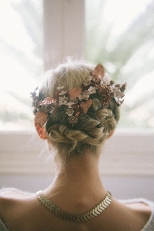 Have your long locks braided into an updo and add flowers to resemble Rapunzel's floral braid for your wedding day!