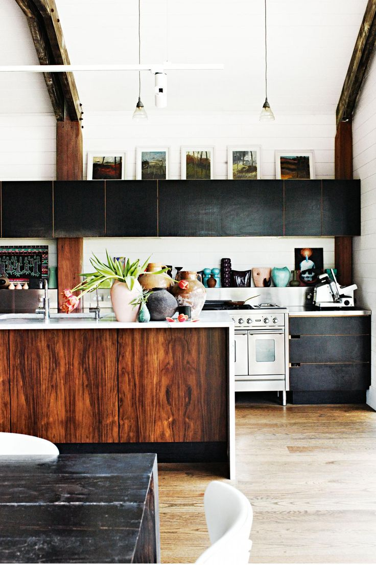 Mixing timber with black cupboard gives a warehouse edge.