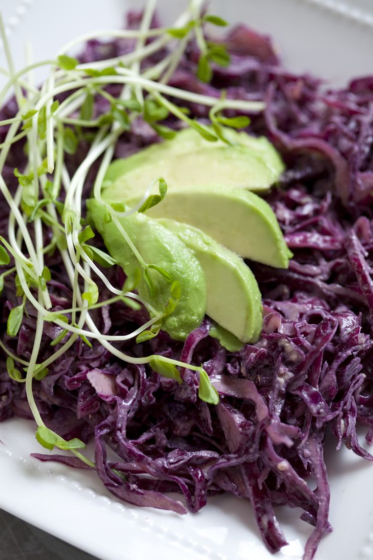 Raw purple slaw. Good for the skin!  ... not a slaw fan personally, but this tahini is a good doing sauce.  Truly I just love eating red cabbage straight!  .... from kimberlysnyder.net
