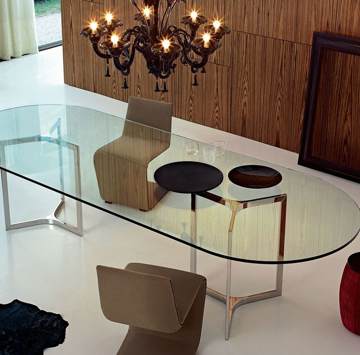 raj light table with transparent glass top and bright stainless steel base designed by