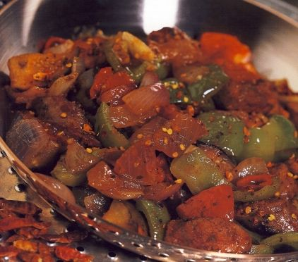 Ingredients: ½ kilo (about 1 pound) fresh beef or pork sausages 4 large green bell peppers, caps removed and seeded 3 Florina preserved red peppers, drained 1 cup Extra Virgin Olive Oil 2 Tbs red wine vinegar 1 tsp dried Greek oregano or 2-3 sprigs fresh oregano 1 cup fresh tomato sauce  salt and freshly ground black pepper to taste
