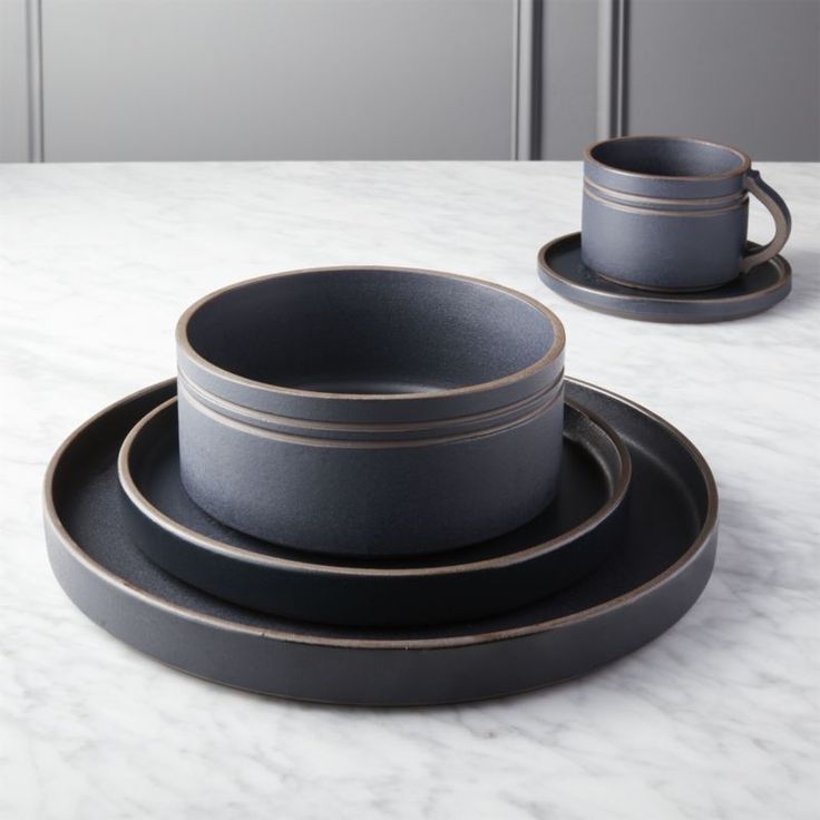 Shop Pitch Dinnerware.   Japanese-inspired ceramics set the table with eclectic style.  Deep matte black glaze coats dark clay stoneware, revealing itself along rims and handles.  Such fine detailing adds texture and a hand-touched feel.